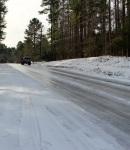 car-climbing-icy-hill