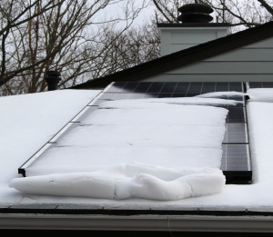 Despite bright sun, our panels were unable to generate any power until the ice finally slid off them.